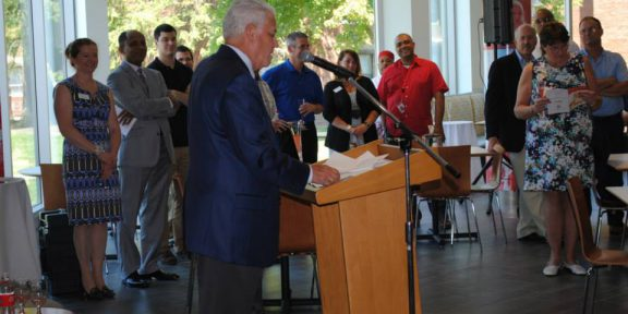 President Harrison speaking to the campus community at the grand re-opening of the University Commons
