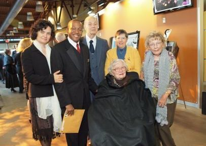 "Elizabeth ""Libby"" Warner-Paranov (Seated) with Hartt School Dean Aaron Flagg and others - Credit: Hartt School"