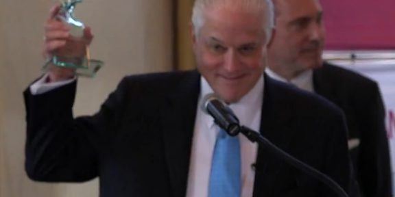 Pres. Walter Harrison receives award.